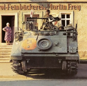 Armoured Personnel Carrier set up in a town during ReForGer. The German people in a town of 1000 people would wake up in the morning and find about 1000 armoured troops, APCs and tanks parked in the village.