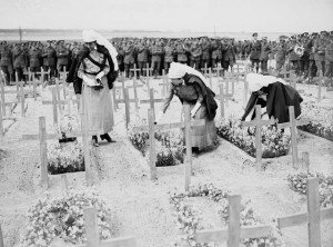 Nursing sisters decorating Canadian graves, 30 June 1918, unknown location.