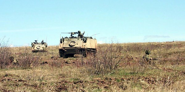 Armoured Personnel Carriers being guarded by dismounted infantry (Photo by Brian Watters).