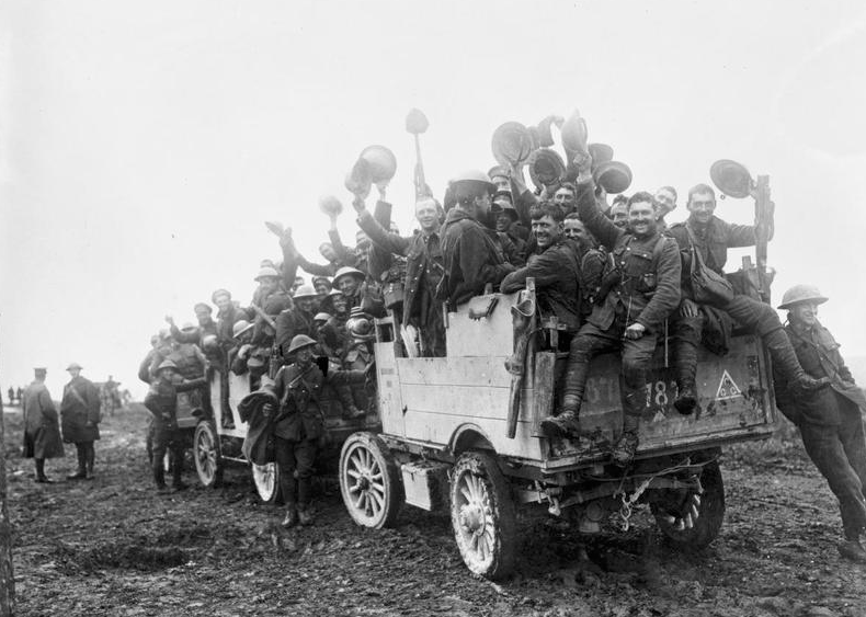 William Ivor Castle_ William Ivor Castle_ Canadian troops returning from the line after the battle of Courcelette on the Somme. The men are piled on the back of a lorry waving and cheering. Imperial War Museum CO829.