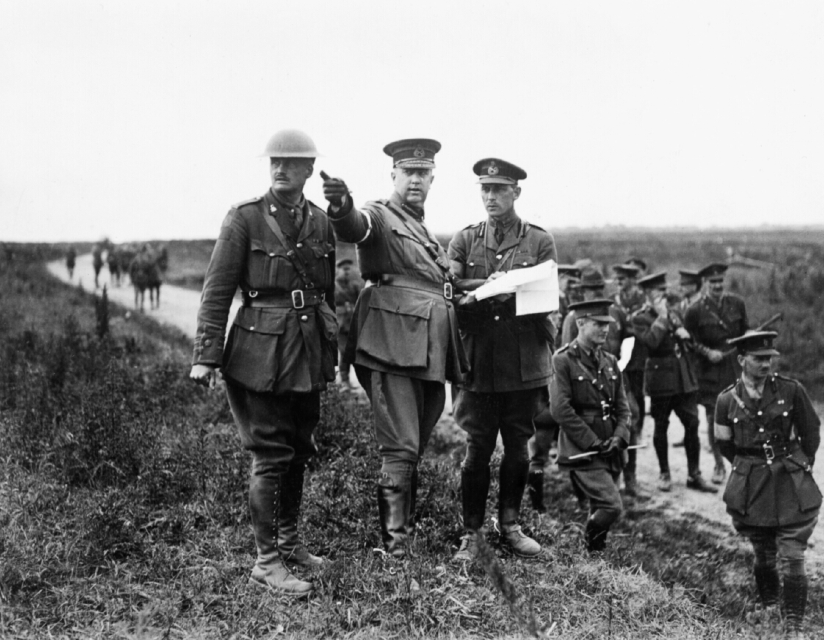 William Rider-Rider_ General Sir Arthur Currie, GOC Canadian Corps (pointing), and General MacBrien with other officers during a training exercise, September 1917. Imperial War Museum, CO1970.