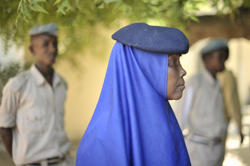 A female Somali police officer watches a training exercise taking place at General Kahiye Police Academy in Mogadishu, Somalia. The African Union Mission in Somalia (AMISOM) is currently training one hundred Somali Police officers in a program aimed at equipping the Somali Police Force with the necessary skills to effectively arrest suspects, stop vehicles at checkpoints, and cordon off areas.(June 2014)