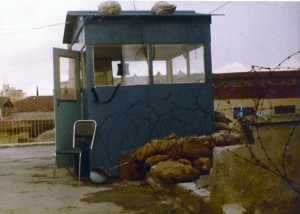 OP Hermes Notice barb wire and sand bags to keep the bad people at bay. Sentry would set on chair with the radio receiver hanging out the window and within easy reach. The blue helmet under chair, just in case. Credit Photo Frank Reid