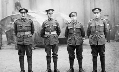 Photograph of Victoria Cross winners, 5 December 1917. Left to right: Private Michael James O'Rourke of the 7th (1st British Columbia) Battalion, Canadian Expeditionary Force, awarded the Victoria Cross in France on 15/17 April 1917. Sergeant James Ockendon of the 1st Battalion, Royal Dublin Fusiliers, awarded the Victoria Cross in Belgium on 4 October 1917. Private William Boynton Butler of the 17th Battalion, West Yorkshire Regiment, awarded the Victoria Cross in France on 6 August 1917. Corporal Ernest Alfred Egerton of the 16th Battalion, Sherwood Foresters, awarded the Victoria Cross in Belgium on 20 September 1917. Imperial War Museum, Q 54252.