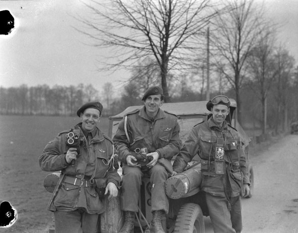 "Photographers of the Canadian Army Film and Photo Unit attached to the 1st Canadian Parachute Battalion. (L-R): Sergeant C.M.G. ""Mike"" Lattion, Sergeant A. H. Calder, Lieutenant Charles H. Richer. Photography by Lieut. Barney J. Gloster/ Dept. of National Defence /Library and Archives Canada/ MIKAN 3524544."