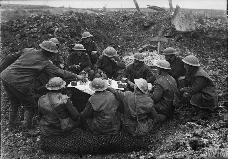 British troops eating their Christmas dinner in a shell hole, Beaumont Hamel, 25th December 1916. Imperial War Museum, Q 1631.