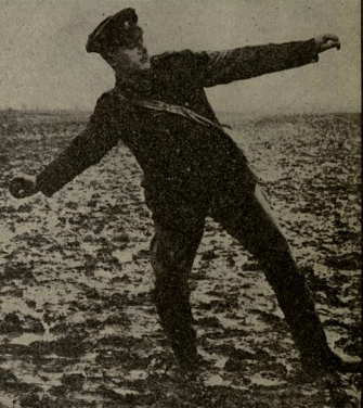 Staged photo earlier than 1916 showing a bomber at the ready position to throw. He has about five seconds to find cover or risk injury. (The Training and Employment of Bombers - SS398, [General Staff at GHQ, September 1916], Plate 1.)