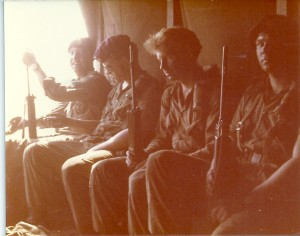 Soldiers in the back of a deuce and a half returning from a ReForGer exercise. (very tired)