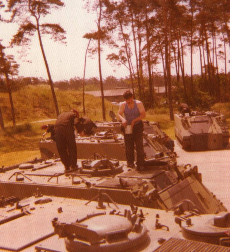 Maintenance being don on the M113 before ReForGer. They were so old sometimes it seemed the many coats of paint held them together Picture by Gerard Carey.