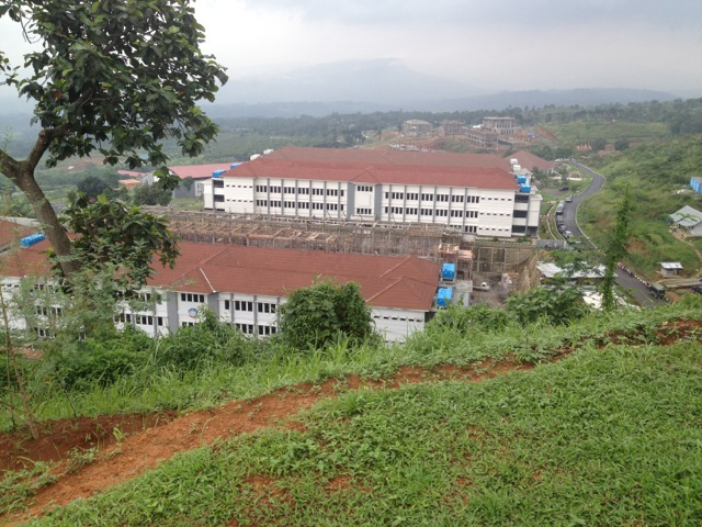 New construction at Sentul, Indonesia: accommodation for a standby unit, with the new Defence University Campus in the distance.