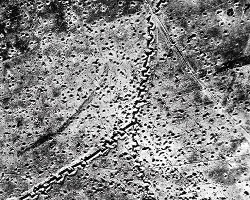 An example of an air photo taken during the Somme showing the junction of Regina and Kenora Trenches. Regina Trench was the scene of repeated failures by the Canadian Corps to capture the fiercely defended German position. - Library And Archives Canada—C-014151