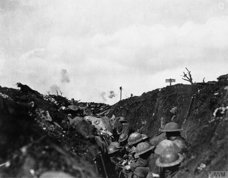 The Battle of Flers Courcelette 15 - 22 September: Shrapnel bursting over Canadian troops sheltering in a reserve trench. Imperial War Museum, CO 802,